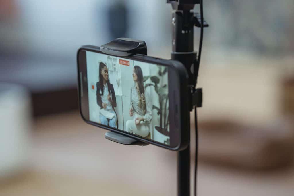 phone recording video of talking women